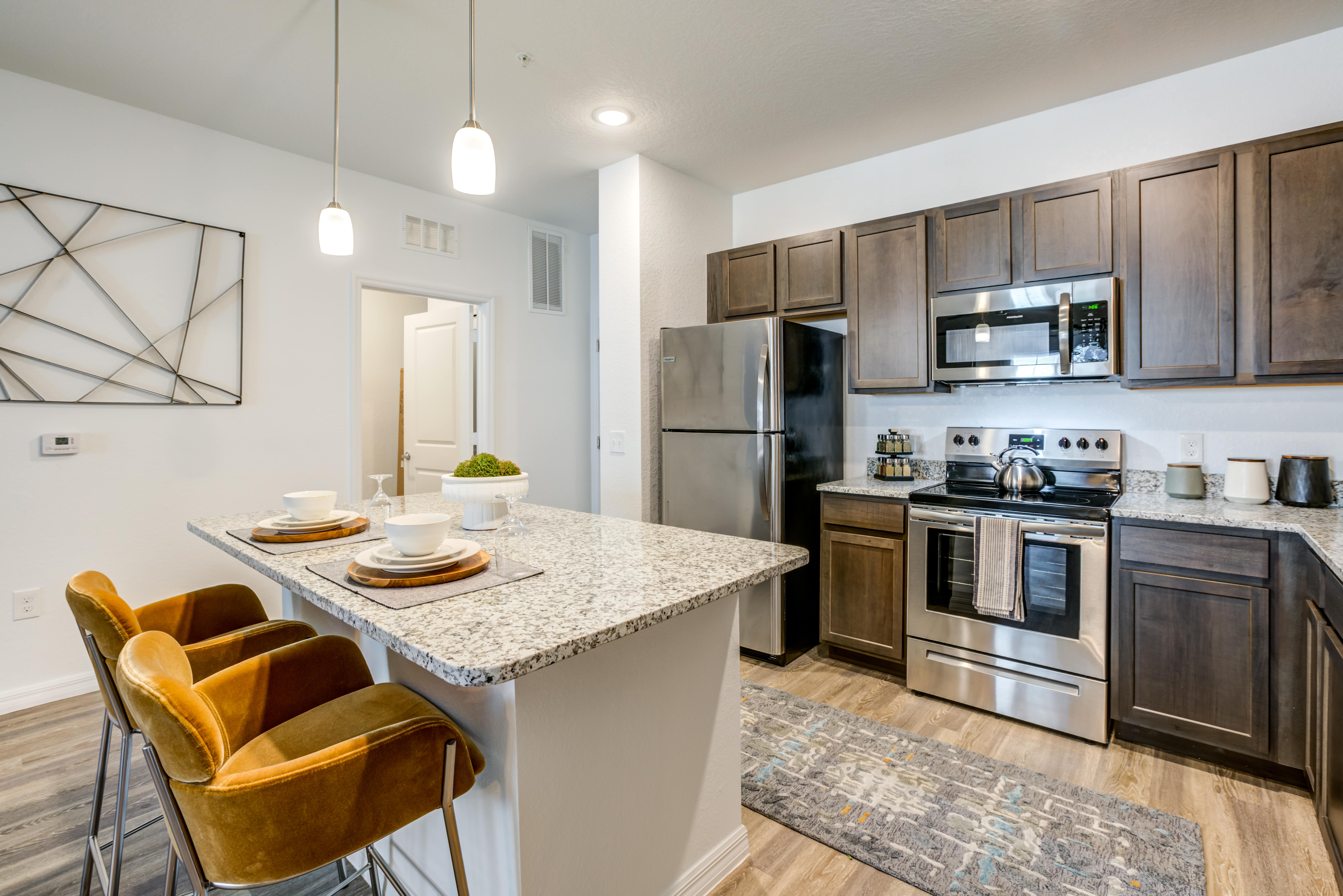Gourmet kitchen with granite counter tops and kitchen island