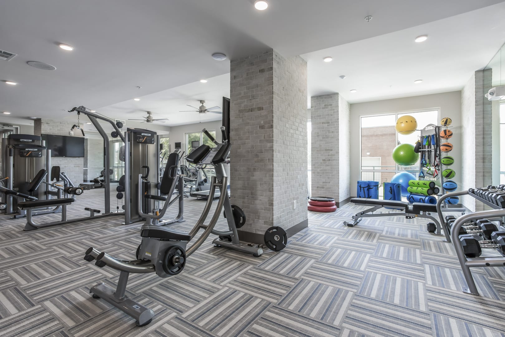Fitness Center With Cardio And Weights at Azure Houston Apartments, Houston, TX, 77007