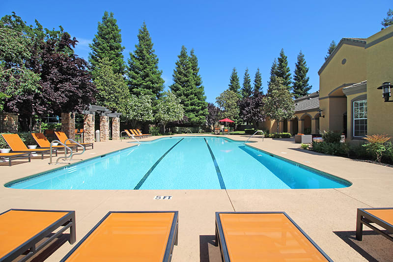 Pool with Lounge Chairs l Oak Brook Apartments in Rancho Cordova CA