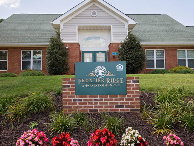 Clubhouse entrace with Frontier Ridge exterior sign