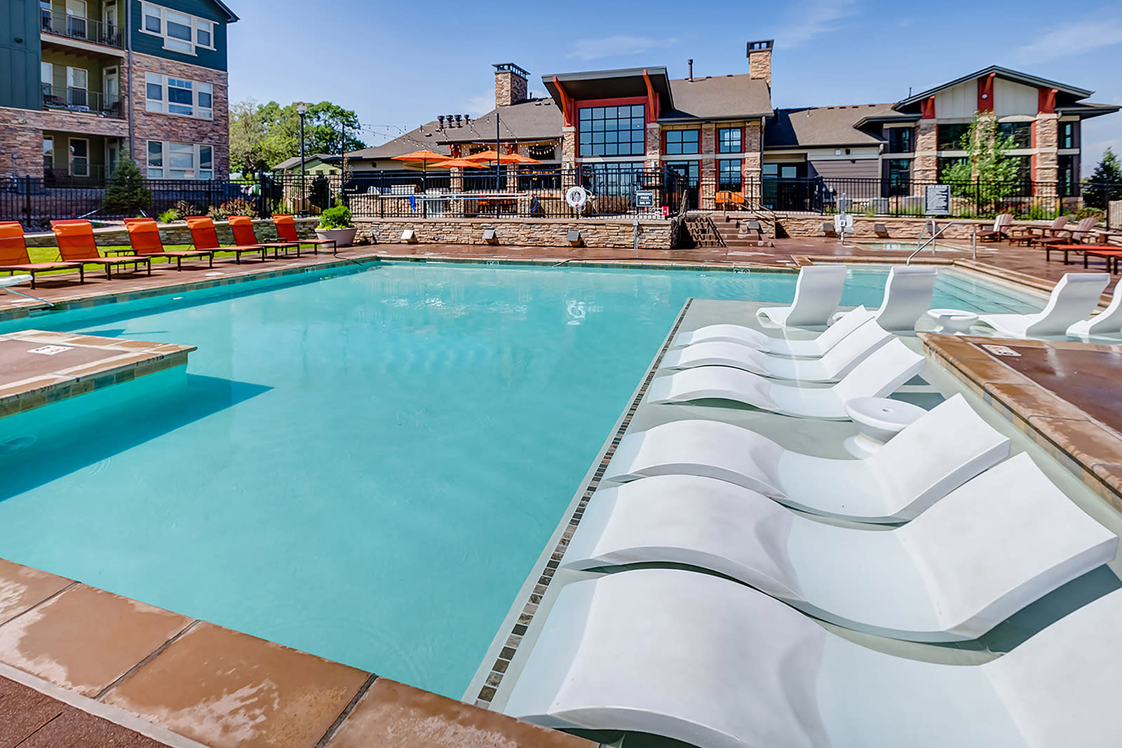 In water lounge chairs at Windsor at Pinehurst, Lakewood, CO