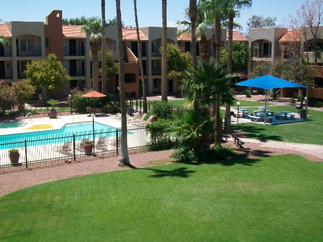 Exterior, landscaping, pool & pool patio at Casa Bella Apartments in Tucson, AZ