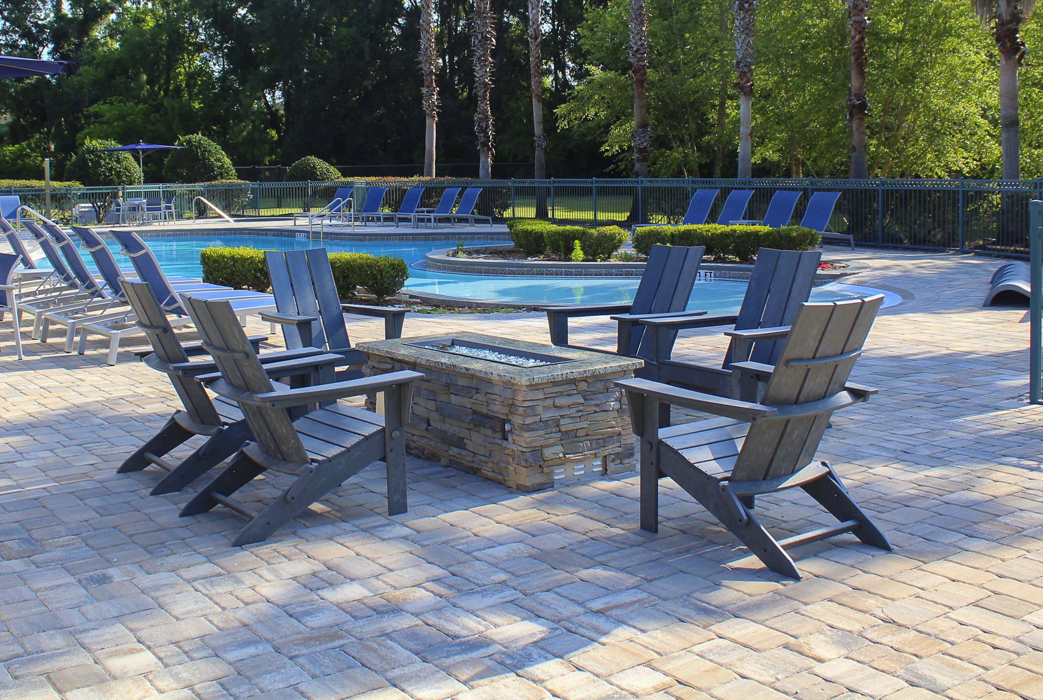 Pool-side gas fire pit with conversational area