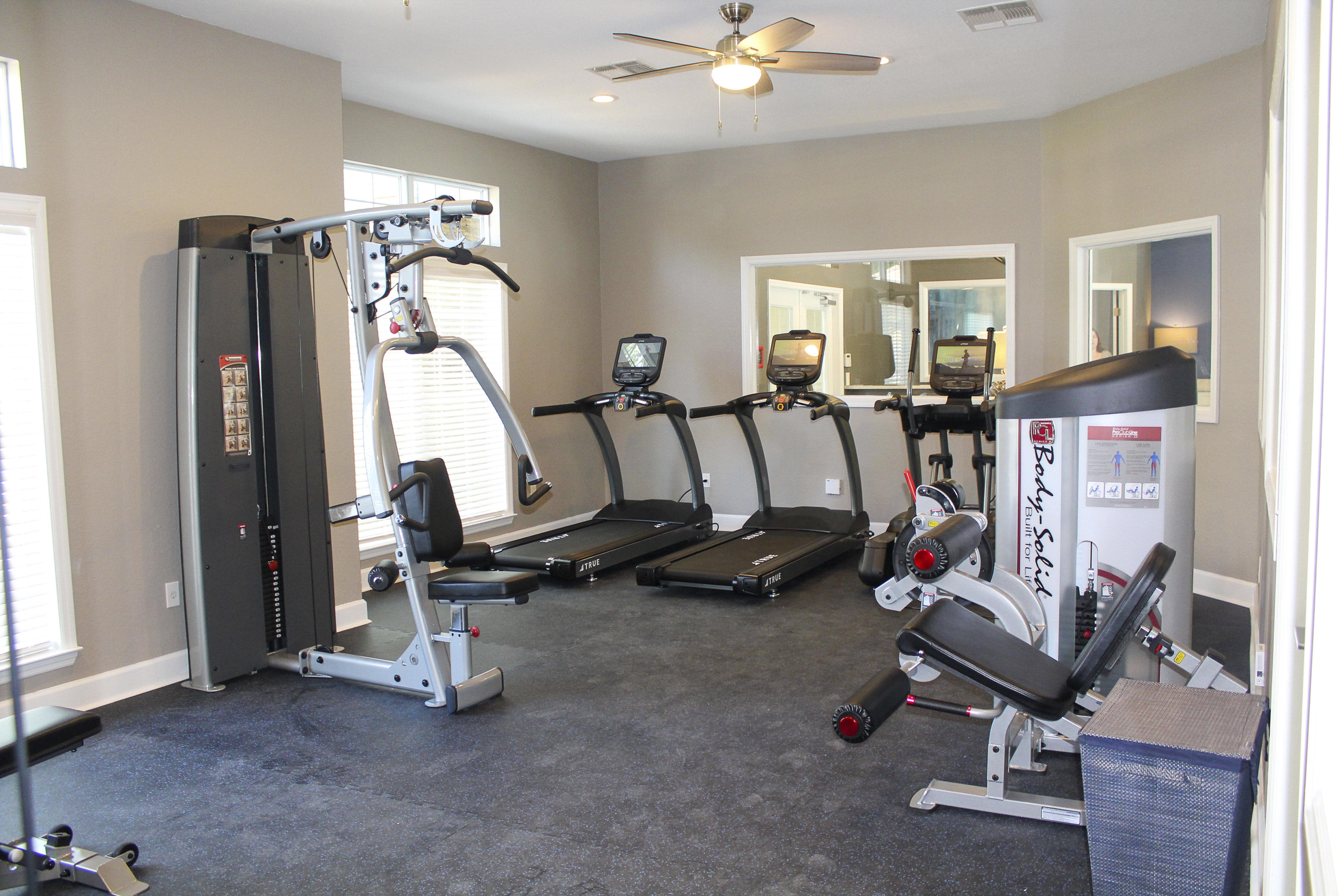Fully-equipped fitness center with free-weights, treadmills, mounted TVs and elliptical machines