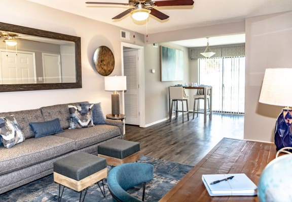 Open concept living room with hardwood floors and access to dining room in Macon, GA apartment rentals