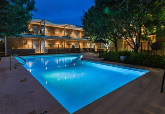 Pool & pool patio at night at The Regency Apartments in Tempe, AZ