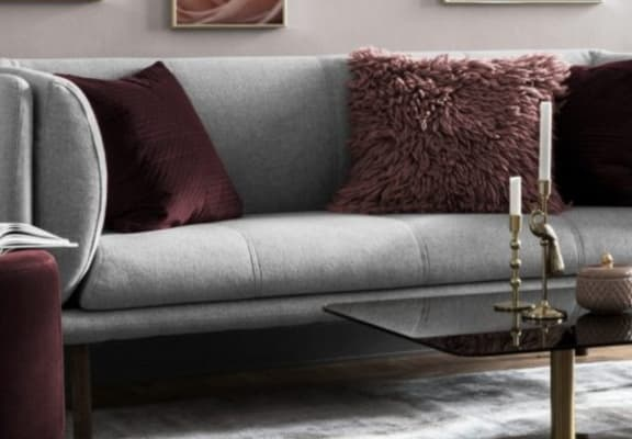 Gray couch with maroon decor