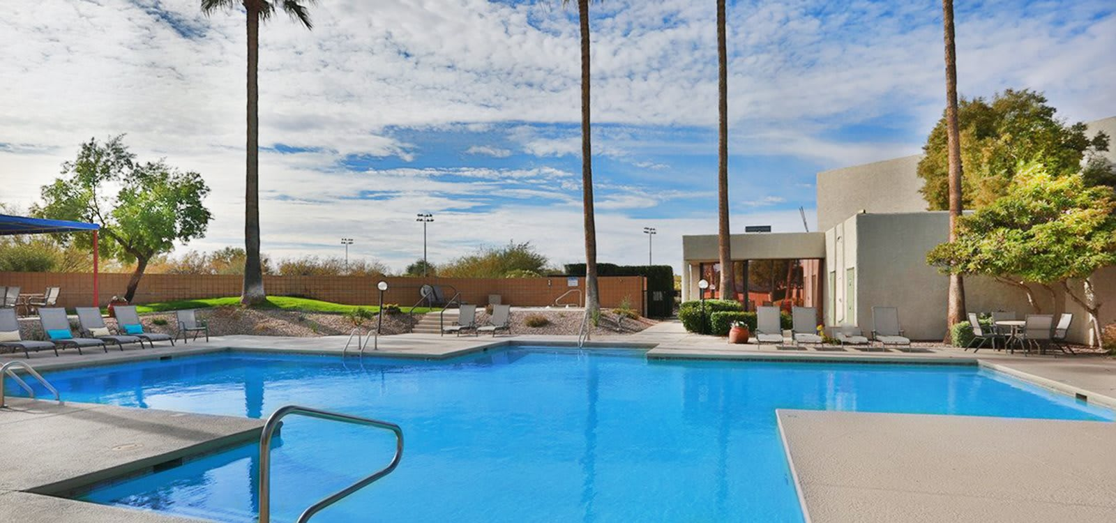 Springhill Apartments Community Pool with lounge chairs around.