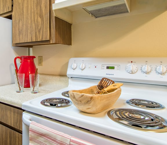 Tanglewood kitchens with electric stoves and matching appliances
