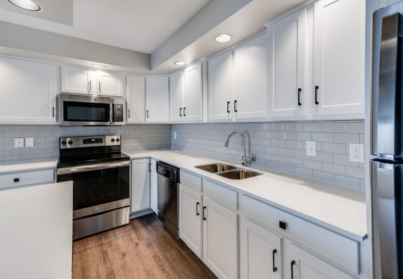 Kitchen with White Cabinetry and Upgraded Hardware