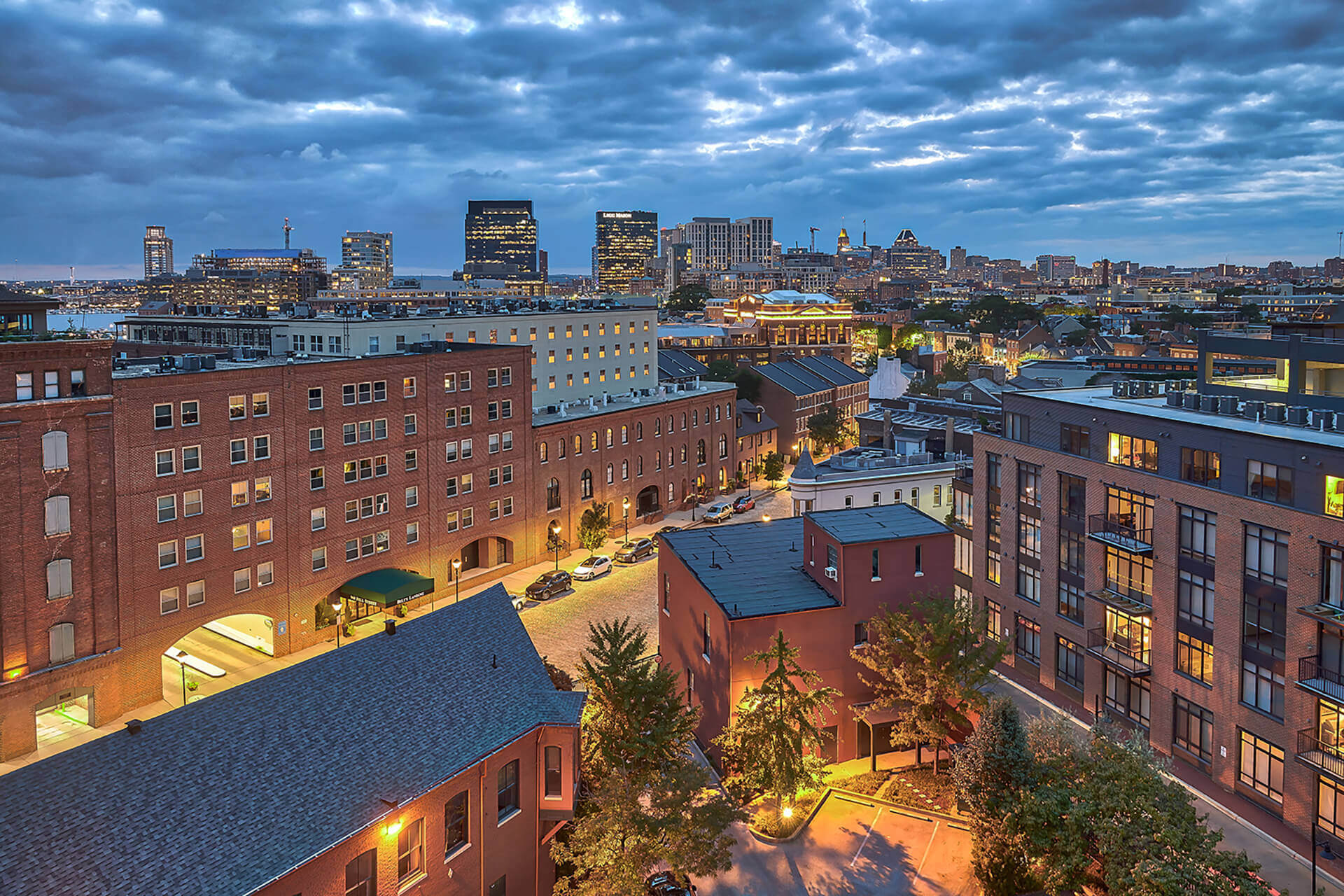 Aeriel view of building and downtown skyline at The Crescent at Fells Point by Windsor, Baltimore, Maryland
