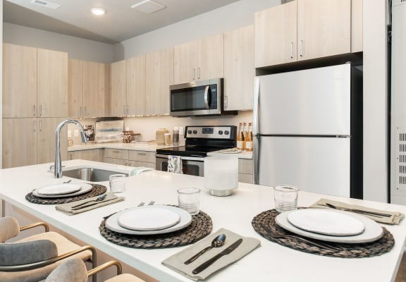 Eat-In Kitchen Table With Sink at Soleil Lofts Apartments, Herriman, Utah