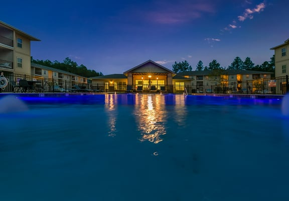Stunning swimming pool with lounging chairs for Reagan Crossing residents in Covington, LA apartments for rent