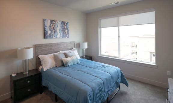 Bedroom With Expansive Windows at Soleil Lofts Apartments, Herriman, UT, 84096