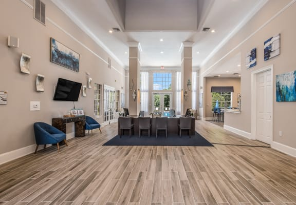 Phenomenal interior of 2626 Park clubhouse with seating areas and televisions in Tallahassee, FL