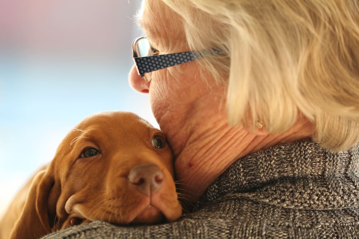 woman with puppy at pet friendly reunion at redmond ridge - an active adult community