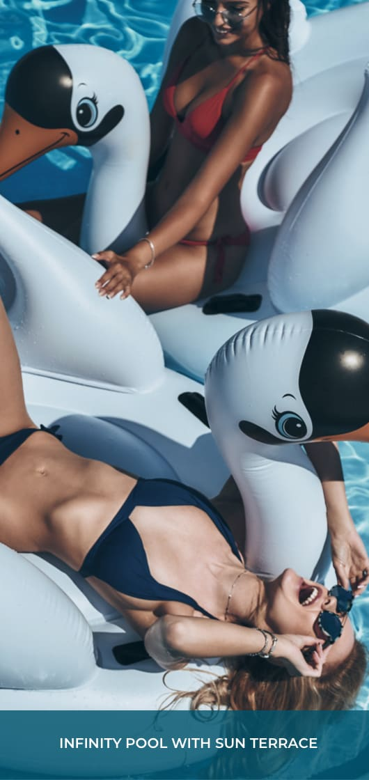 "two young women on swan floatation devices in a pool and text that says ""Infinity Pool with Sun Terrace"""