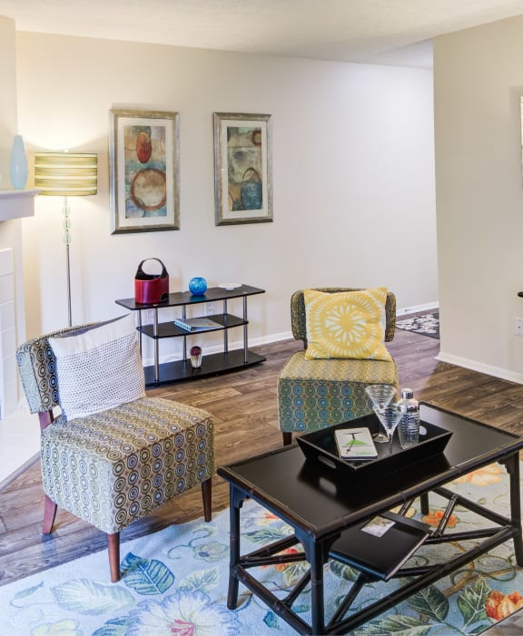 Furnished interior with fireplace and vinyl flooring
