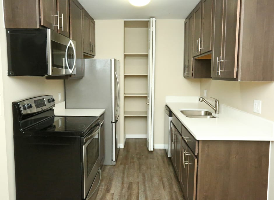 Renovated kitchen with granite counters, stainless appliances and new cabinets