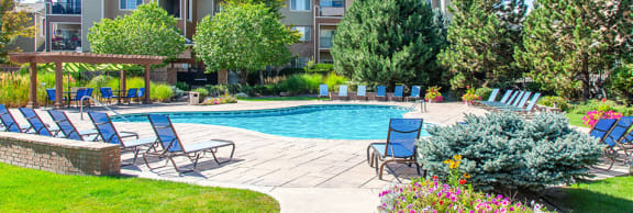 Swimming Pool And Relaxing Area at Indigo CreekApartments, Thornton, Colorado