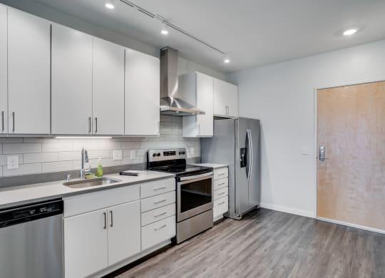 Spacious Kitchen with Grey Hardwood Style Flooring