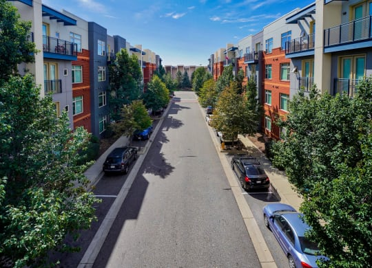 Landscaped street with parking at The District, CO, 80222