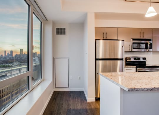 Kitchen Islands in select apartment homes at Waterside Place by Windsor, Boston, 02210