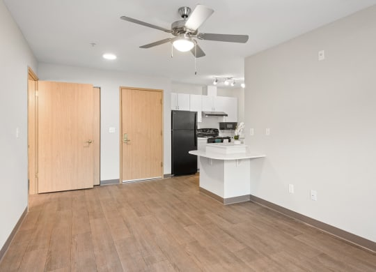 Upgraded Kitchen and Living Room at Meridian Court Apartments in Federal Way WA