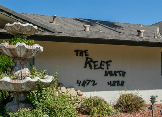 Property Signage at Reef Apartments, Fresno, 93704