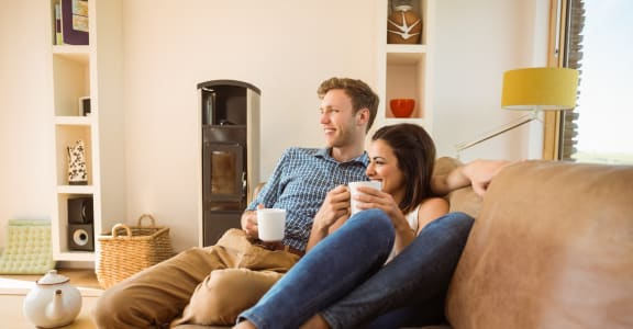 stock image- young couple on couch