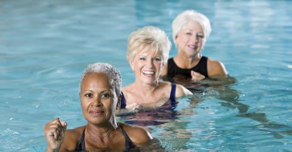 Senior Enjoying Pool at 55+ FountainGlen Goldenwest Senior Apartments, Westminister