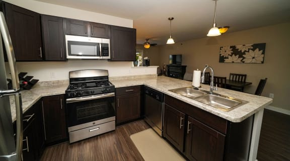 Fully Equipped Kitchen With Modern Appliances at Trade Winds Apartment Homes, Elkhorn, Nebraska