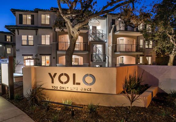 Yolo Apartments signage