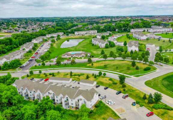 Drone View of Apartment Buildings and Greenery at West Hampton Park Apartment Homes, Elkhorn
