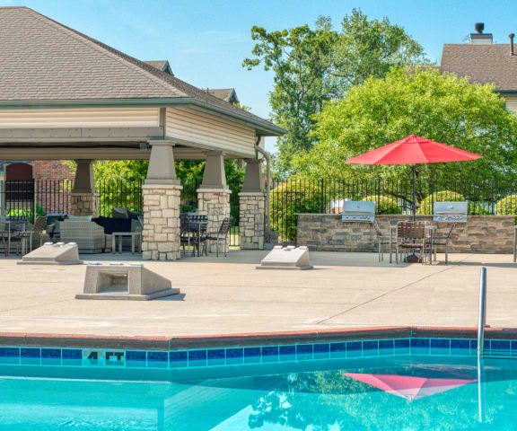 Swimming Pool With Relaxing Sundecks at Main Street Village Apartments, Granger