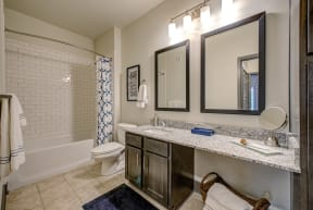 large bathroom with two mirrors