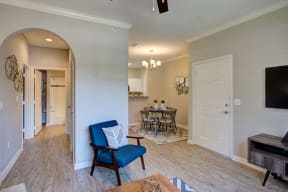 Living room/dining area with arch way interior wall in fort collins