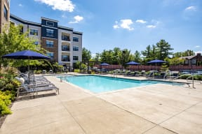 large outdoor pool with building skyline