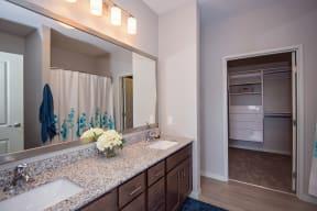 Large Bathroom Vanity with Granite Countertops and Dual Sinks