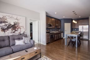 Open Concept Living with Wood Style Flooring Throughout the Kitchen and Living Room