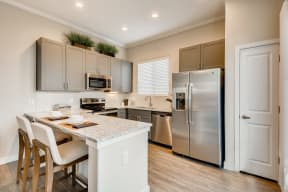 Gourmet Kitchen With Island at Avilla Parkway, Texas