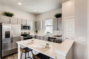 Gourmet Kitchen With Island at Avilla Eastlake, Thornton