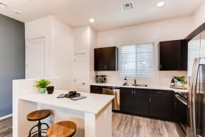 Fitted Kitchen With Island Dining at Avilla Lehi Crossing, Arizona, 85213