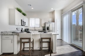 Fitted Kitchen With Island Dining at Avilla Enclave, Mesa, AZ