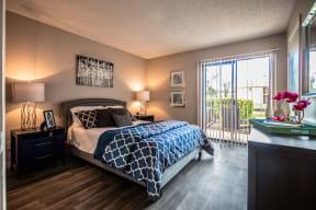 Avisa lakes spacious bedroom with wood like flooring