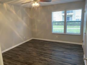 Avisa Lakes Platinum Upgrade unit bedroom with wood plank flooring