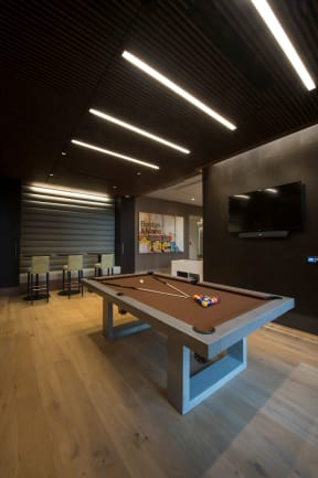 Game room with billiards | The Merc at Moody and Main
