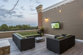 Rooftop patio with seating and outdoor televisions