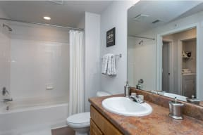 Bathroom with tile surround  |Cypress Legends
