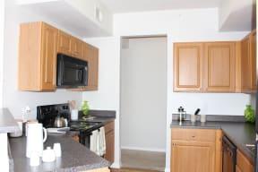 Updated Kitchen With Black Appliances| Cypress Legends